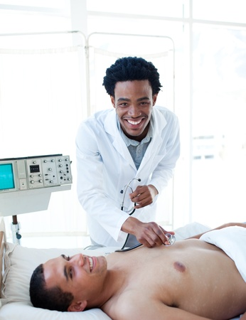 Afro-american doctor examining a patient photo
