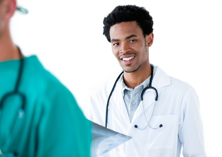 Afro-american male doctor standing against a white background Stock Photo - 10110023