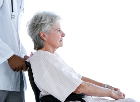 Portrait of a senior woman sitting on a wheelchair in a hospital photo