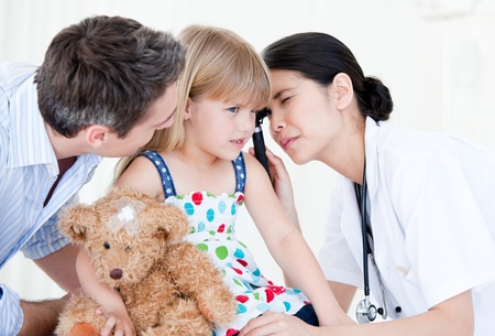 Radiant female doctor examining little girl with medical equipment Stock Photo - 10111970