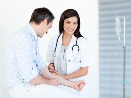 Smiling female doctor making injection to her patient  photo