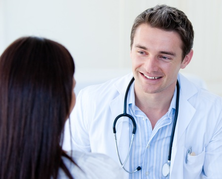Portrait of a male doctor talking with his patient photo
