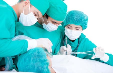 Professionnal medical team using surgery equipment on a patient photo