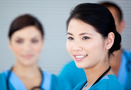 surgical nurse: Smiling female doctor with her teamates