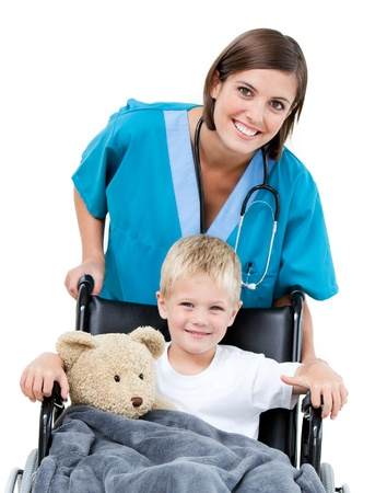 medicine wheel: Nice female doctor carrying adorable little boy in the wheelchair at the hospital Stock Photo