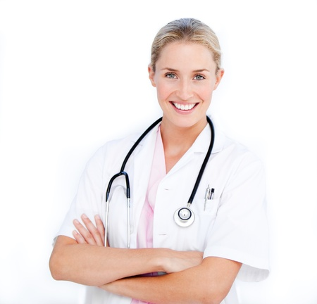 Caucasian female doctor folding arms against white background photo