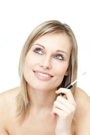 Portrait of a blond woman holding a lipstick photo