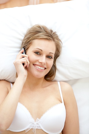 Cheerful woman in underwear talking on phone  Stock Photo - 10114716