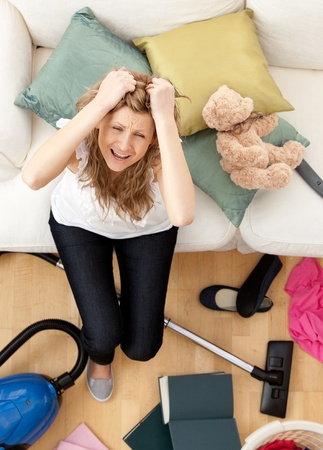 Stressed young woman doing housework  photo