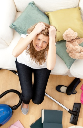 Frustrated young woman doing housework photo