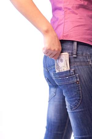 hands in pockets: Woman with Dollars in her pocket