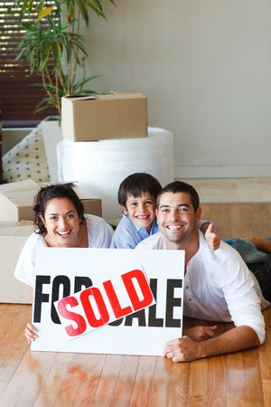 Family on the floor after buying house with copy-space photo