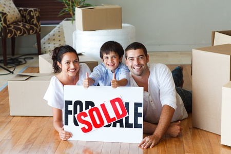Happy family lying on the floor after buying house photo