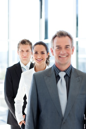 Young businesswoman in focus with her team photo