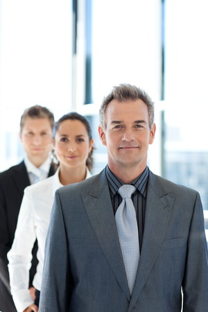 people in a row: Businessman leading a business team in a line