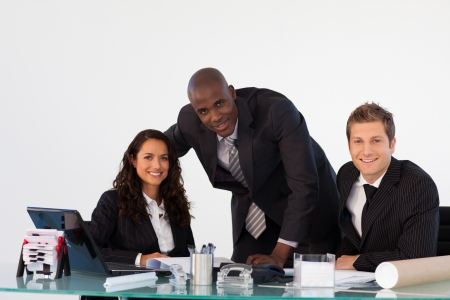 Business team in an office smiling at the camera photo