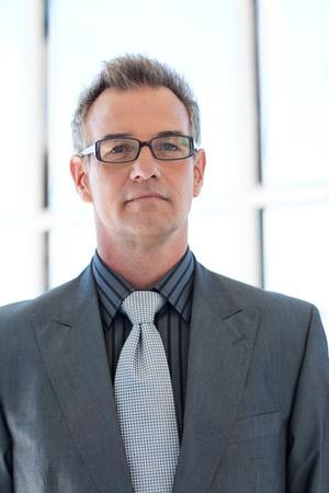 Senior businessman wearing glasses photo