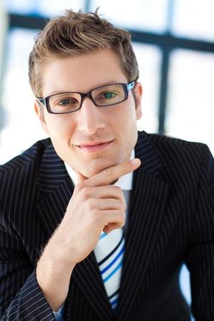 Handsome businessman wearing glasses photo