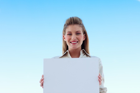 Businesswoman holding a white business card photo