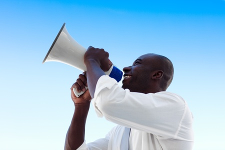 A businessman shouting in a megaphone photo