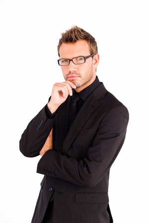 Confident businessman with glasses looking at the camera Stock Photo - 10115228
