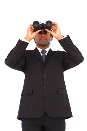 Serious afro-american businessman manager using binoculars  photo