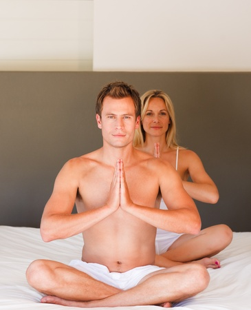 Couple doing exercises on bed Stock Photo - 10115134