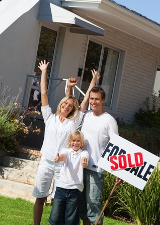 A family buying a house photo