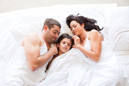 Nice familiy sleeping together photo