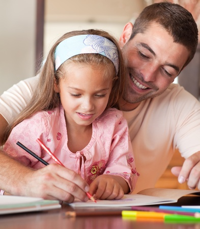 Handsome father helping her daughter for homework photo