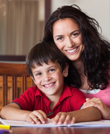 Bright mother helping his son for homework photo