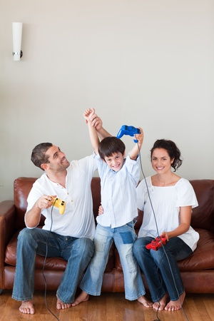 Loving family playing video games in the living-room photo