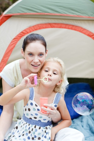 Mother and daughter together in tent photo