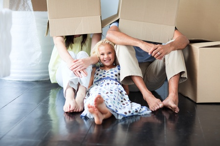 family moving house: Family having fun after moving house