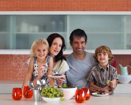 Lovely family eating in a kitchen Stock Photo - 10128613