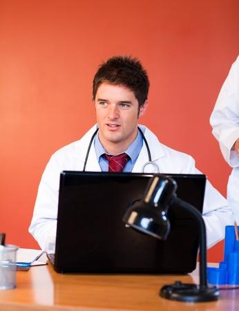 Handsome businessman using a laptop  photo