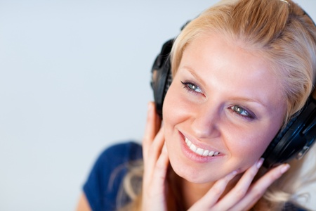 Portrait of an attractive woman with headphones  photo