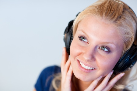 Close-up of an attractive woman with headphones  photo