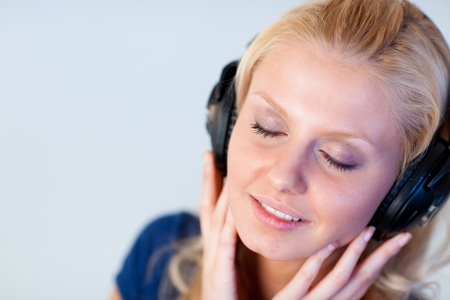Young woman with closed eyes and headphones  photo
