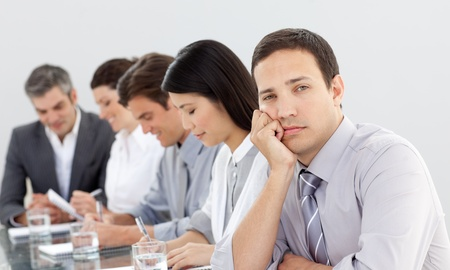 bored man: Bored businessman in a meeting Stock Photo