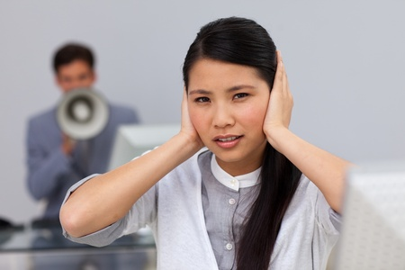 Businesswoman covering her ears  photo