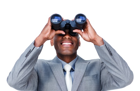 security search: Smiling businessman looking through binoculars  Stock Photo