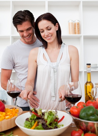 Portrait of a smiling couple cooking photo