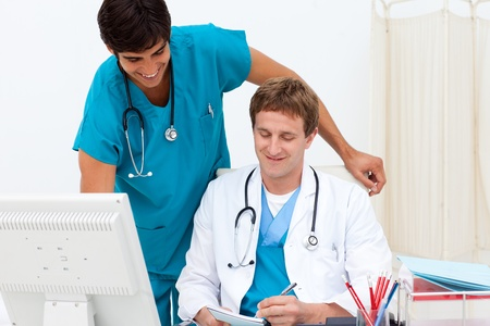A doctor and a medical intern talking about a patient photo