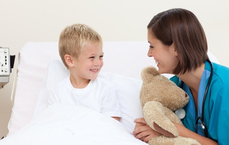 Female doctor having fun with her little patient Stock Photo - 10115160