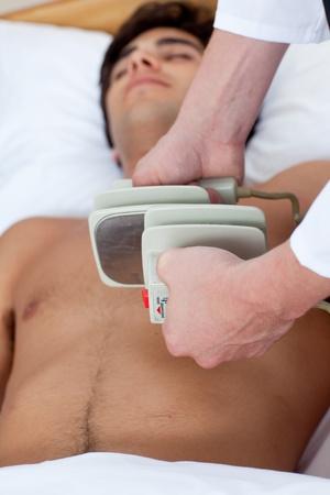 arrhythmias: A doctor preparing a defibrillation Stock Photo