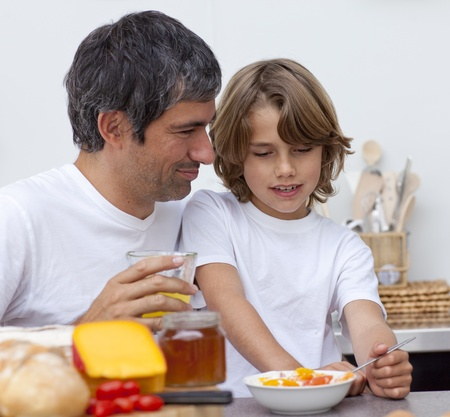 Portrait of father and son having breakfast together photo