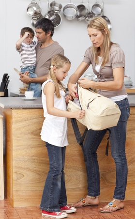 Mother and daughter preparing the bag for school photo