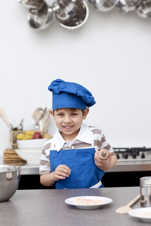 Little child ready to bake Stock Photo - 10114797