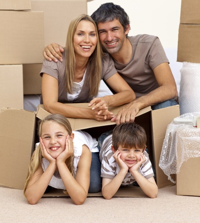 Family in new house playing with boxes photo